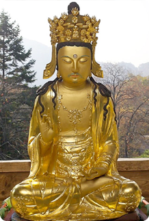 Wooden statue of the seated Avalokitesvara